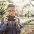 Постер, плакат: Girl makes photos in park
