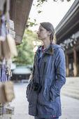 Woman near Temple — Stock Photo