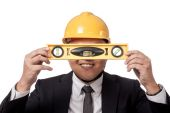 Asian businessman hold a spirit level in front of his eyes and s — Stock Photo