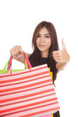 Asian woman show shopping bags and  thumbs up — Foto de Stock