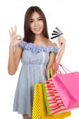 Beautiful Asian woman show OK sign with many credit cards — Stock Photo