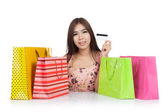 Beautiful Asian woman show a credit card with  shopping bags on  — Stock Photo