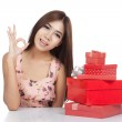 Beautiful Asian woman show OK with red gift box — Stock Photo #54147057
