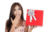 Excited  beautiful Asian woman open a  red gift box — Stock Photo