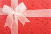 Red gift box with white ribbon — Stock Photo