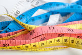 Colorful  untidy  measuring tapes — Stock Photo