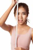 Asian skinny girl with measuring tape — Stock Photo