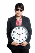 Asian man hold a clock in font of him — Stockfoto