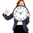 Asian businesswoman point to a clock over her face — Foto Stock #55573897