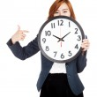 Asian businesswoman point to a clock over her face — Photo #55573897