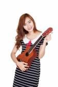 Asian girl tune ukulele — Stock Photo