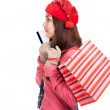 Asian girl with red christmas hat ,credit card and shopping bag — Stock Photo #56378001