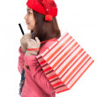 Asian girl with red christmas hat ,credit card and shopping bag — Stock Photo #56378055