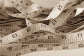 Untidy measuring tapes — Stock Photo