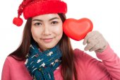 Asian girl with red christmas hat and red heart — Stock Photo