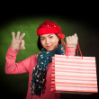 Asian girl show OK with christmas hat and shopping bag — Stock Photo #56685919