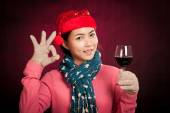 Asian girl with christmas hat show OK with wine — ストック写真