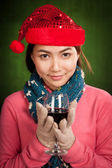 Asian girl with red christmas hat with glass of wine — Stock Photo