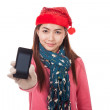 Asian girl with red christmas hat show mobile phone — Stock Photo #57559037