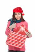 Asian girl with christmas hat pull gift box from shopping bag — Foto de Stock