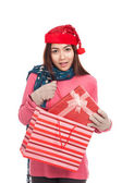 Asian girl with christmas hat pull gift box from shopping bag — Foto Stock