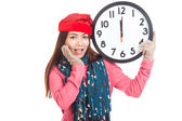 Asian girl wear  red christmas hat excited with clock at midnigh — Stock fotografie