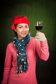 Asian girl wear christmas hat cheers with wine — Stock Photo