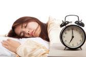 Sleeping Asian girl with alarm clock — Stock Photo