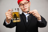 Asian businessman decide drink or drive — Stock Photo