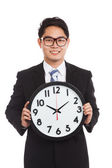 Asian businessman with a clock — Stock Photo