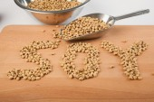 Soybean in shape of soy word  with transfer scoop — Stock Photo