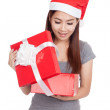 Asian girl with red santa hat open a gift box and smile — Stock Photo #60097673