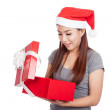 Asian girl with red santa hat open and look inside a gift box — Stock Photo #60097711