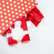 Red gift boxes and and christmas hat in shopping bags — ストック写真 #60544563