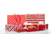 Red gift boxes and shopping bags — Stok fotoğraf