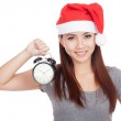 Asian girl with red santa hat and alarm clock — Stock Photo #60951903