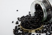 Black beans in a jar on white  table with lid off — Stock Photo