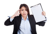 Young Asian businesswoman worry with blank clipboard — Stock Photo