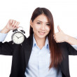 Young Asian businesswoman thumbs up with alarm clock — Stock Photo #61613653