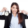Young Asian businesswoman show v sign with alarm clock — Stock Photo #61613809