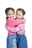Asian twin sisters hug each other with love — Stock Photo