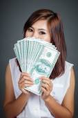 Beautiful Asian girl hold over size 100 dollar bills — Stock Photo