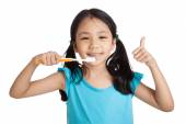 Little asian girl thumbs up with toothbrush — Stock Photo