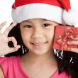 Happy little asian girl show OK with santa hat and gift box — Stock Photo #77155711