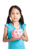 Little asian girl smile with piggy bank — Stock Photo