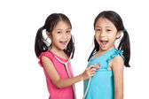 Happy Asian twins girls with stethoscope — Stock Photo