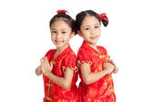 Asian twins girls in  chinese cheongsam dress with gesture of co — Stock Photo