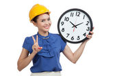 Asian engineer woman show victory sign with a clock — Stock Photo