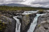 Petrohue beautiful waterfalls with Osorno Volcano behind, Chil — Stock Photo