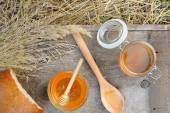 Fragrant, fresh, golden honey with rye bread. — Stock Photo
